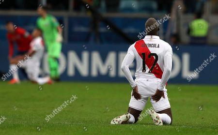 Peru's goalkeeper Carlos Caceda reacts during a Copa America semifinal soccer match against Chile at the Arena do Gremio in Porto Alegre, Brazil