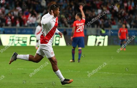 Peru's Edison Flores celebrates scoring his side's opening goal during a Copa America semifinal soccer match against Chile at the Arena do Gremio in Porto Alegre, Brazil