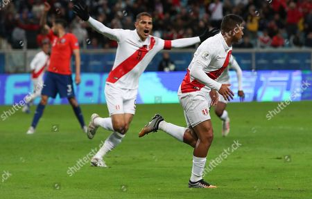 Peru's Edison Flores, right, celebrates scoring his side's opening goal with teammate Paolo Guerrero during a Copa America semifinal soccer match against Chile at the Arena do Gremio in Porto Alegre, Brazil