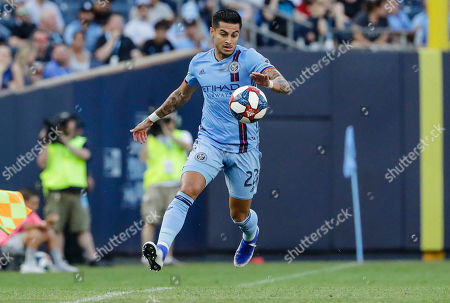 New York City's Ronald Matarrita (22) keeps the ball in bounds during the first half of an MLS soccer match against the Seattle Sounders, in New York