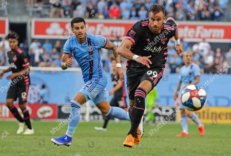 Seattle Sounders's Justin Dhillon (99) and New York City's Ronald Matarrita (22) vie for the ball during the first half of an MLS soccer match, in New York