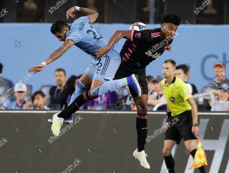 New York City's Ronald Matarrita, left, and Seattle Sounders's Saad Abdul-Salaam, right, vie for the ball during the second half of an MLS soccer match, in New York. New York City FC won 3-0