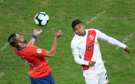 Chile's Mauricio Isla, left, and Peru's Edison Flores fight for the ball during a Copa America semifinal soccer match at Arena do Gremio in Porto Alegre, Brazil