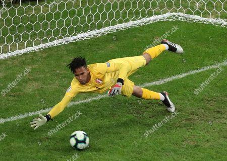 Peru's goalkeeper Pedro Gallese stops a shoot on goal to Chile's Arturo Vidal during a Copa America semifinal soccer match at Arena do Gremio in Porto Alegre, Brazil