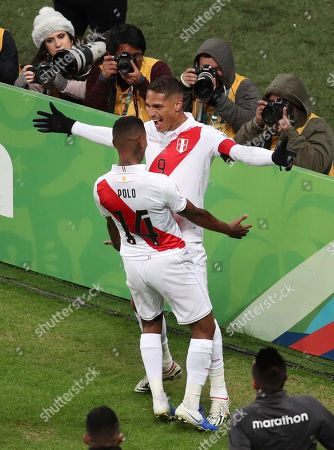 Peru's Paolo Guerrero, right, celebrates his side's third goal against Chile with Andy Polo during a Copa America semifinal soccer match at Arena do Gremio in Porto Alegre, Brazil