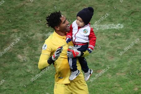 Peru's goalkeeper Pedro Gallese celebrates with his son at the end of Copa America semifinal soccer match against Chile at Arena do Gremio in Porto Alegre, Brazil, . Peru won the game 3-0 and advance to the final
