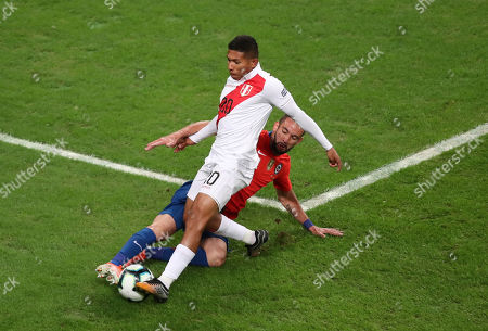 Peru's Edison Flores, front, and Chile's Mauricio Isla fight for the ball during a Copa America semifinal soccer match at Arena do Gremio in Porto Alegre, Brazil