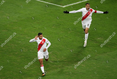 Peru's Edison Flores, left, celebrates after scoring his side's opening goal abasing Chile during a Copa America semifinal soccer match at Arena do Gremio in Porto Alegre, Brazil