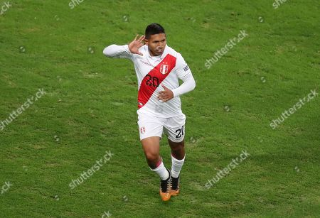 Peru's Edison Flores celebrates after scoring his side's opening goal abasing Chile during a Copa America semifinal soccer match at Arena do Gremio in Porto Alegre, Brazil
