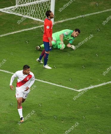 Peru's Edison Flores, front, celebrates after scoring his side's opening goal abasing Chile during a Copa America semifinal soccer match at Arena do Gremio in Porto Alegre, Brazil