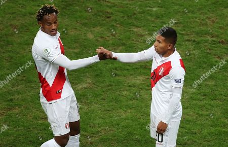 Peru's Edison Flores, right, is congratulated by Andre Carrillo after scoring his side's opening goal against Chile during a Copa America semifinal soccer match at Arena do Gremio in Porto Alegre, Brazil