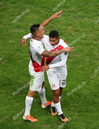 Peru's Victor Yotun, left, is congratulated by Edison Flores after he scoring his side's second goal against Chile during a Copa America semifinal soccer match at Arena do Gremio in Porto Alegre, Brazil