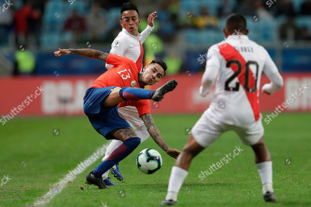 Chile's Erick Pulgar, center, competes for the ball between Peru's Christian Cueva, and Peru's Edison Flores during a Copa America semifinal soccer match at the Arena do Gremio in Porto Alegre, Brazil