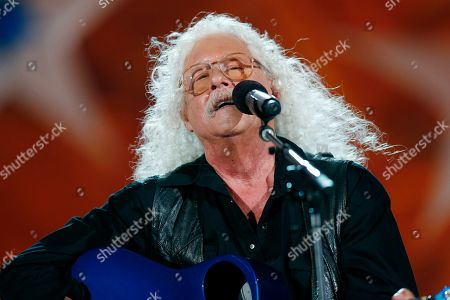 Arlo Guthrie performs during the dress rehearsal for the Boston Pops Fireworks Spectacular in Boston