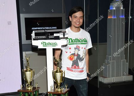 Stock Image of Competitor Matt Stonie participates in Nathan's Famous international Fourth of July hot dog eating contest weigh-in at the Empire State Building, in New York