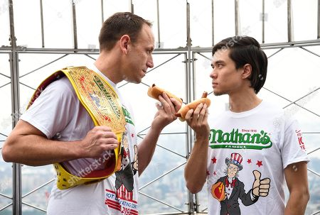 Stock Photo of Joey Chestnut, Matt Stonie. Eleven-time and defending men's champion Joey Chestnut, left, and former champion and number three ranked eater in the world Matt Stonie pose together during Nathan's Famous international Fourth of July hot dog eating contest weigh-in at the Empire State Building, in New York
