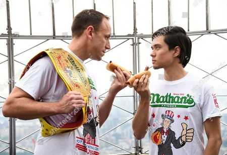 Joey Chestnut, Matt Stonie. Eleven-time and defending men's champion Joey Chestnut, left, and former champion and number three ranked eater in the world Matt Stonie pose together during Nathan's Famous international Fourth of July hot dog eating contest weigh-in at the Empire State Building, in New York