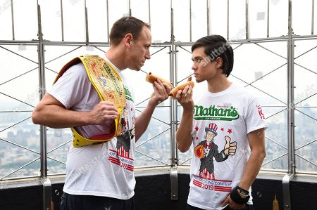 Stock Picture of Joey Chestnut, Matt Stonie. Eleven-time and defending men's champion Joey Chestnut, left, and former champion and number three ranked eater in the world Matt Stonie pose together during Nathan's Famous international Fourth of July hot dog eating contest weigh-in at the Empire State Building, in New York
