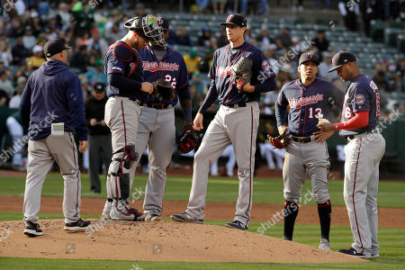 Kyle Gibson, Wes Johnson. Minnesota Twins pitcher Kyle Gibson, center, waits to speak to pitching coach Wes Johnson, left, in the second inning of a baseball game against the Oakland Athletics, in Oakland, Calif