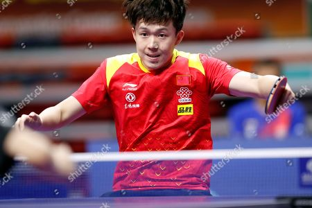 Wang Chuqin of China in action against Yun-ju Lin of Taiwan during the men's singles table tennis round of 32 match at the Seamaster 2019 International Table Tennis Federation (ITTF) World Tour Shinhan Korea Open at Sajik Gym in Busan, South Korea, 04 July 2019.