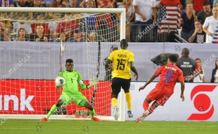 United States midfielder Clint Dempsey (8) scores past Jamaica goalkeeper Sydney Schneider (1) for the first goal during the CONCACAF Gold Cup semi-final match between Jamaica and United States at Nissan Stadium in Nashville, Tennessee. (Photo Credit: Steve Roberts/ CSM