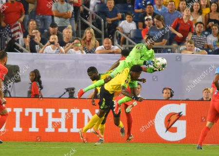 Stock Image of during the CONCACAF Gold Cup semi-final matchJamaica goalkeeper Sydney Schneider (1) goes up over United States midfielder Clint Dempsey (8) between Jamaica and United States at Nissan Stadium in Nashville, Tennessee. (Photo Credit: Steve Roberts/ CSM