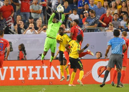 during the CONCACAF Gold Cup semi-final matchJamaica goalkeeper Sydney Schneider (1) goes up over United States midfielder Clint Dempsey (8) between Jamaica and United States at Nissan Stadium in Nashville, Tennessee. (Photo Credit: Steve Roberts/ CSM