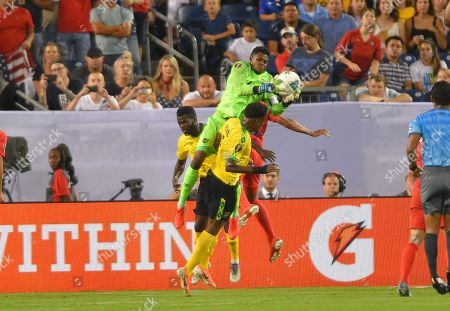 Stock Photo of during the CONCACAF Gold Cup semi-final matchJamaica goalkeeper Sydney Schneider (1) goes up over United States midfielder Clint Dempsey (8) between Jamaica and United States at Nissan Stadium in Nashville, Tennessee. (Photo Credit: Steve Roberts/ CSM