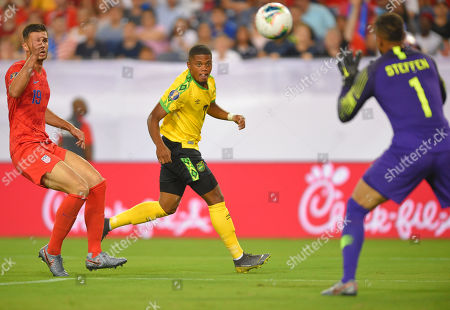 United States goalkeeper Brad Guzan (1) blocks the shot of Jamaica midfielder Chinyelu Asher (7) during the CONCACAF Gold Cup semi-final match between Jamaica and United States at Nissan Stadium in Nashville, Tennessee. (Photo Credit: Steve Roberts/ CSM
