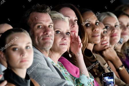 US actors Anne Heche (3-L) and Thomas Jane (2-L) and German actress Natalia Woerner (4-L) and Barbara Becker watch the Riani show during the Mercedes-Benz Fashion Week in Berlin, Germany, 03 July 2019. The Spring/Summer 2020 collections are presented at the MBFW Berlin from 01 to 03 July.