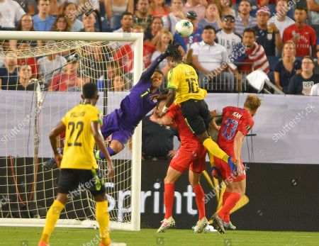 United States goalkeeper Brad Guzan (1) blocks the shot of Jamaica forward Jody Brown (10) during the CONCACAF Gold Cup semi-final match between Jamaica and United States at Nissan Stadium in Nashville, Tennessee. (Photo Credit: Steve Roberts/ CSM
