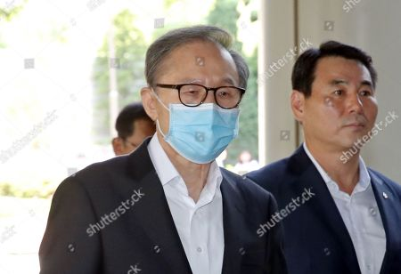 South Korean Former President Lee Myung-bak (L) arrives at the High Court in Seoul, South Korea, 04 July 2019, to attend a hearing. Lee, who was released on bail from a detention center on 06 March, is appealing a 15-year sentence for bribery, embezzlement and other acts of corruption.