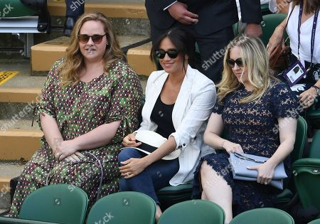 Stock Photo of Meghan Duchess of Sussex with friends Genevieve Hillis (L) and Lindsay Roth watching the action on Court 1