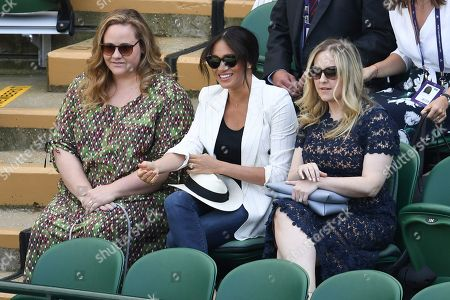 Stock Image of Meghan Duchess of Sussex with friends Genevieve Hillis (L) and Lindsay Roth watching the action on Court 1