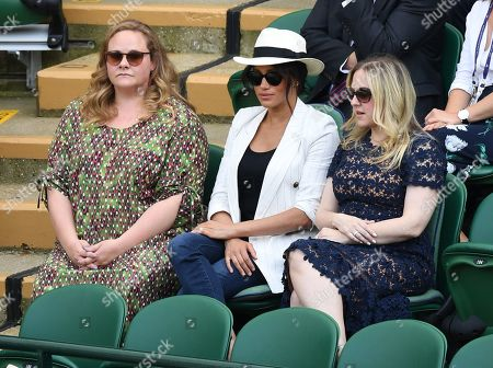 Stock Picture of Meghan Duchess of Sussex with friends Genevieve Hillis (L) and Lindsay Roth watching the action on Court 1