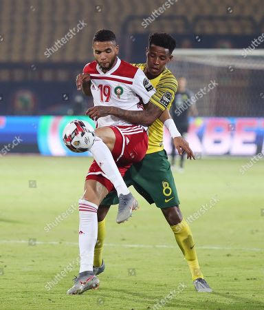Youssef En-Nesyri (L) of Morocco shields the ball from Bongani Zungu of South Africa  during the 2019 Africa Cup of Nations (AFCON) group D soccer match between South Africa and Morocco at  Al-Salam Stadium in Cairo, Egypt, 01 July 2019.