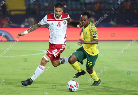 Manuel Da Costa (L) of Morocco is challenged by Percy Tau of South Africa during the 2019 Africa Cup of Nations (AFCON) group D soccer match between South Africa and Morocco at  Al-Salam Stadium in Cairo, Egypt, 01 July 2019.