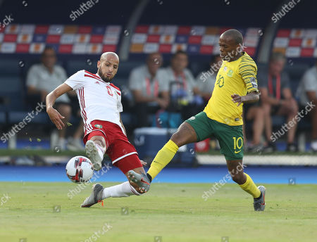 Stock Photo of Karim El Ahmadi (L) of Morocco is challenged by Thulani Serero of South Africa during the 2019 Africa Cup of Nations (AFCON) group D soccer match between South Africa and Morocco at  Al-Salam Stadium in Cairo, Egypt, 01 July 2019.