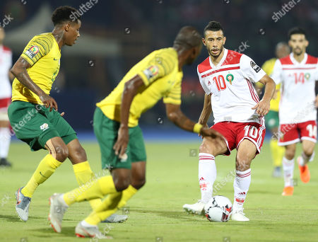 Younes Belhanda (R) of Morocco in action during the 2019 Africa Cup of Nations (AFCON) group D soccer match between South Africa and Morocco at  Al-Salam Stadium in Cairo, Egypt, 01 July 2019.