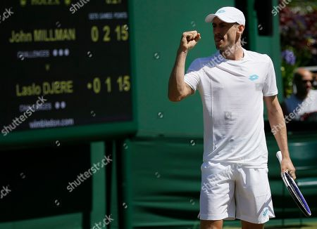 Australia's John Millman reacts after winning a point against Serbia's Laslo Djere in a Men's singles match during day four of the Wimbledon Tennis Championships in London