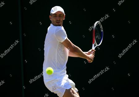 Australia's John Millman returns to Serbia's Laslo Djere in a Men's singles match during day four of the Wimbledon Tennis Championships in London