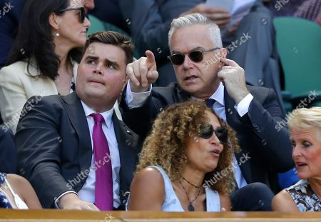 Newsreader Huw Edwards, top right, takes his seat in the Royal Box on Centre Court during day four of the Wimbledon Tennis Championships in London