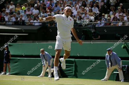 Switzerland's Roger Federer returns to Britain's Jay Clarke in a Men's singles match during day four of the Wimbledon Tennis Championships in London