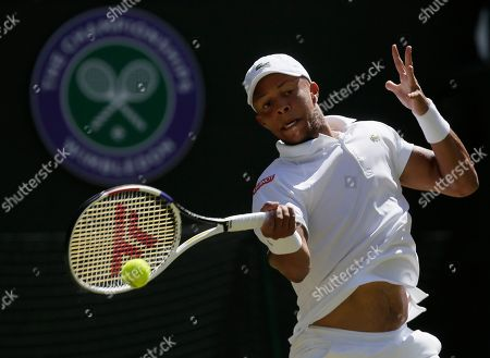 Britain's Jay Clarke returns to Switzerland's Roger Federer in a Men's singles match during day four of the Wimbledon Tennis Championships in London