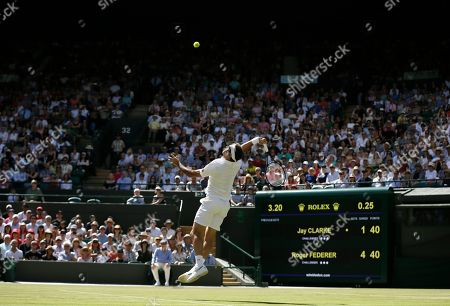 Switzerland's Roger Federer smashes a return to Britain's Jay Clarke in a Men's singles match during day four of the Wimbledon Tennis Championships in London