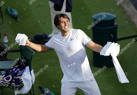 Marcos Baghdatis of Cyprus throws clothing to spectators after after losing to Italy's Matteo Berrettini in a Men's singles match during day four of the Wimbledon Tennis Championships in London, . Baghdatis was set to retire after this championship