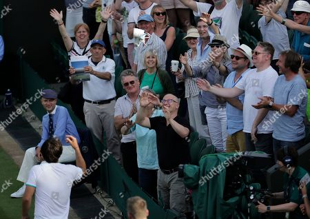 Marcos Baghdatis of Cyprus throws his shoes to spectators after after losing to Italy's Matteo Berrettini in a Men's singles match during day four of the Wimbledon Tennis Championships in London, . Baghdatis was set to retire after this championship