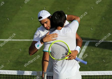 Marcos Baghdatis of Cyprus is embraced by Italy's Matteo Berrettini after losing a Men's singles match during day four of the Wimbledon Tennis Championships in London, . Baghdatis was set to retire after this championship