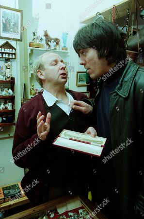 Stock Photo of Ep 2884 Friday 30th March 2001 After Gloria leaves the pawnbrokers, Cain enters with the necklace he stole from her and is offered £35. With Alec Meades, as played by Colin Meredith, and Cain Dingle, as played by Jeff Hordley.