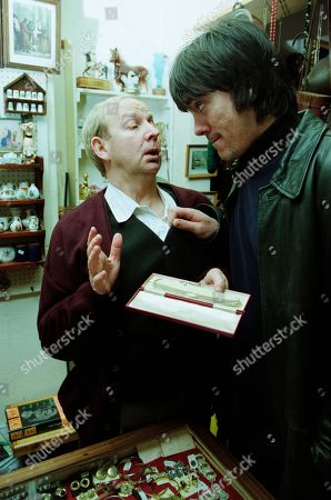 Stock Image of Ep 2884 Friday 30th March 2001 After Gloria leaves the pawnbrokers, Cain enters with the necklace he stole from her and is offered £35. With Alec Meades, as played by Colin Meredith, and Cain Dingle, as played by Jeff Hordley.